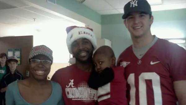 Little Starla Chapman and family meets Alabama Quarterback AJ McCarron. (Source: YOUTUBE)