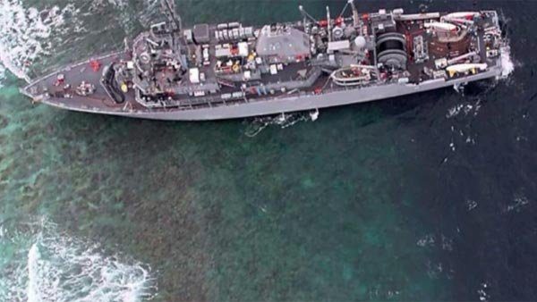 Rough seas have hindered efforts to survey the reef where a U.S. minesweeper ran aground Thursday. (Source: the U.S. Navy via CNN)