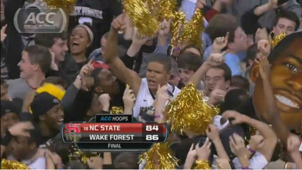 Wake Forest fans participated in an all-too common occurrence lately, when they stormed the court after a victory against NC State. (Source: ACC Digital Network)