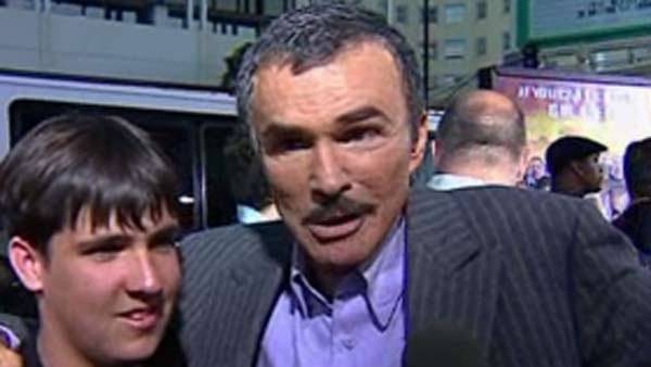 Burt Reynolds, right,  went to the hospital after becoming dehydrated. (Source: CNN)