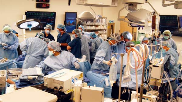 Surgeons at Johns Hopkins Hospital perform a 13-hour double arm transplant on Brendan Marrocco. (Source: Johns Hopkins Hospital)