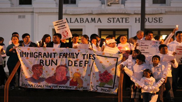 Immigrants and their families protested outside the Montgomery, AL stat