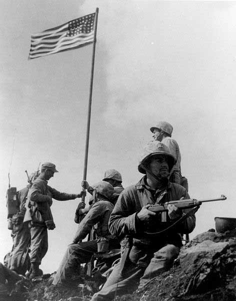 Rosenthal's picture actually captured the second flag raising on the island. This picture was taken for a Marine Corps magazine shortly after a the first flag was raised. (Source: Wikipedia)