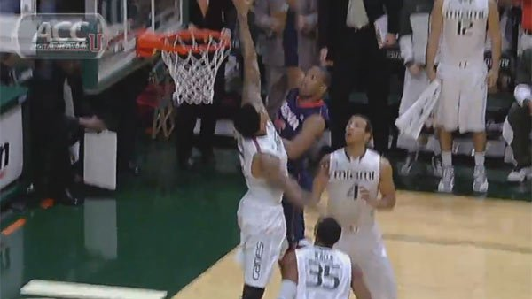Miami's Julian Gamble gets back-to-back-to-back blocks on Virginia's Akil Mitchell in their low scoring affair Tuesday.  (Source: ACC Digital Network)