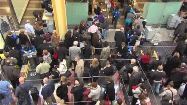 Longer lines, delays and cancellations would occur at airports nationwide if the forced budget cuts take effect on March 1. (Source: CNN)