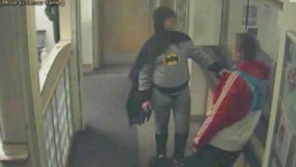 The caped crusader made an appearance at a UK police department turning in a criminal, and it was caught on tape. (Source: CNN).