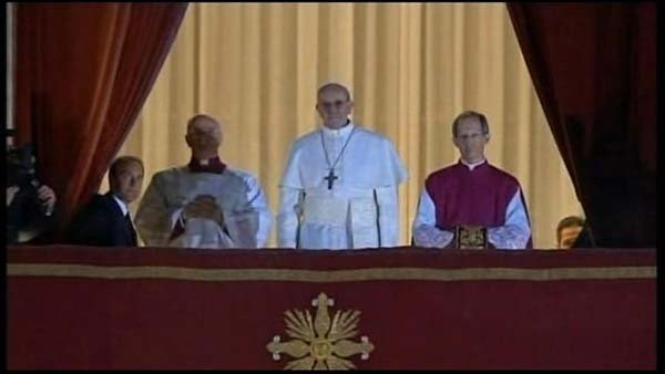 Newly elected Pope Francis I, formerly Cardinal Jorge Mario Bergoglio, greets the crowd outside St. Peter's Basilica. (Source: Vatican TV/CNN)
