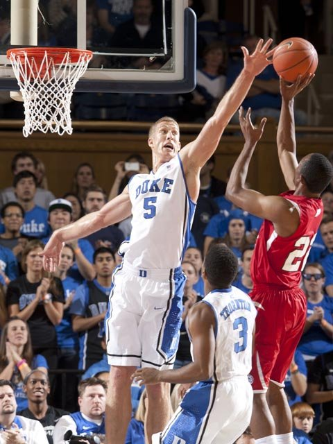 The Duke Blue Devils, led by Mason Plumlee (5), aim to stem t