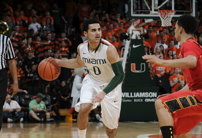 With four seniors by his side in the starting lineup, Miami sophomore Shane Larkin (0) emerged as a leader on the court for coach Jim Larranaga. (Source: Miami Athletics)
