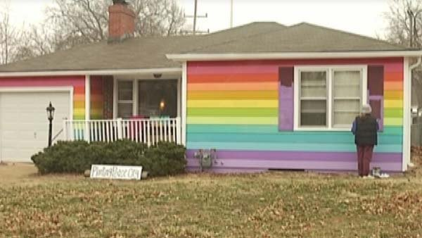 A rainbow-colored home sits across the street from Westboro Baptist Church. (Source: CNN/KTKA)