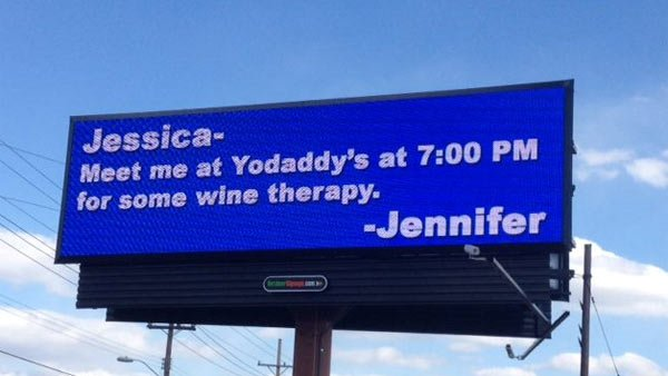 The latest billboard message from a scorned wife mentions the restaurant owned by the owner of the billboard. (Source: WFMY News 2)
