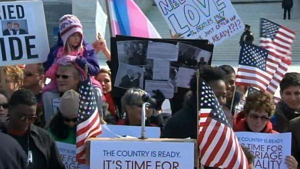 Supporters of same-sex marriage rally outside of the Supreme Court while arguments on the Defense of Marriage Act are heard. (Source: CNN)
