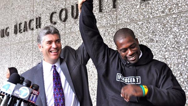 Brian Banks raising arms in celebration after exoneration. (Source: California Innocence Project/ MGN)