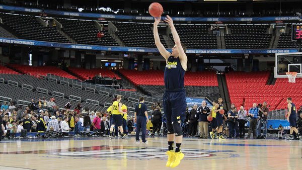 Michigan's Nik Stauskas shoots a 3-point attempt at practice Friday in the Georgia Dome. He and the Wolverines face the Syracuse Orange in the second Final Four game Saturday. (Matt Quillen/RNN)