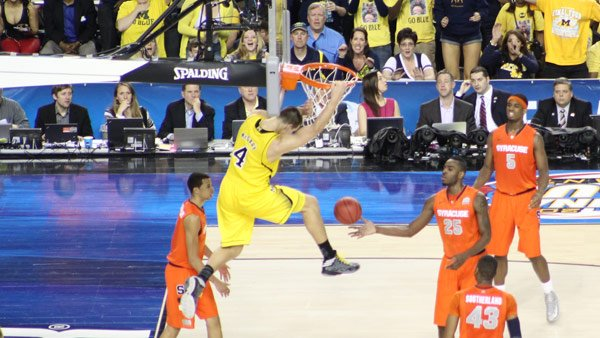Mitch McGary slams it home in the second half of the Michigan-Syracuse game in Atlanta on Saturday. (Source: Matt Quillen/RNN)