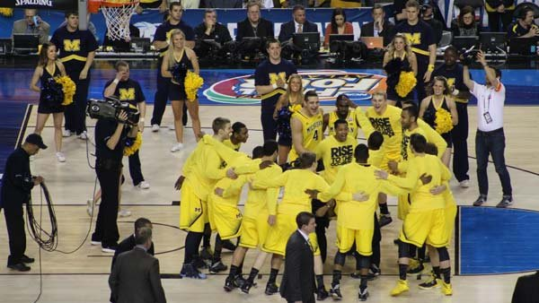 The Michigan Wolverines huddle ahead of the championship game. (Source: Matt Quillen/RNN)