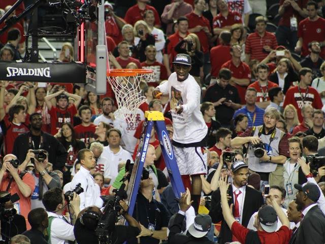 Louisville's Russ Smith cuts down the net following his team's 82-76 win over Michigan in the NCAA championship in Atlanta. (Matt Quillen/RNN)