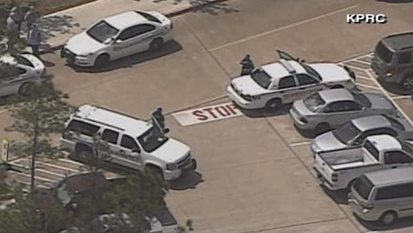 Officials secure the scene on Lone Star College's campus. (Source: KPRC/CNN)