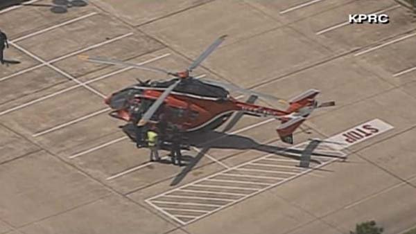 Emergency officials load someone onto a medical helicopter after reports of a stabbing at Lone Star College near Houston. (Source: KPRC/CNN)