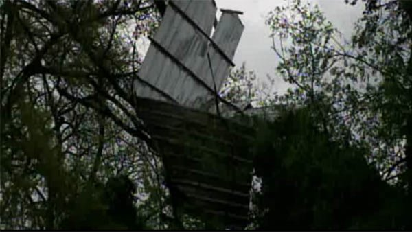 High winds and a possible tornado ripped roofs off buildings and in to trees in Rome, GA Thursday. (Source: WXIA/CNN)