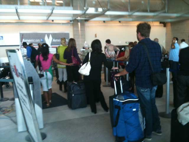 Passengers wait at the American Airlines counter in Little Rock, AR. (Source: DeAnn Smith/KCTV)
