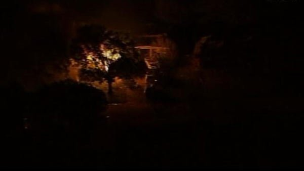 A house caught fire due to the plant explosion. (Source: DFW Scanner)