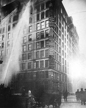 Firefighters battle the blaze at the Triangle Shirtwaste Factory. The fire spread quickly and many workers were trapped in the building. (Source: Wikicommons)
