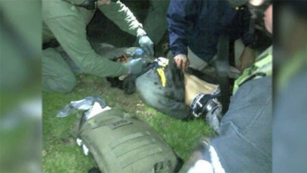 An image of Dzhorkar Tsarnaev moments after his capture hiding in a boat in Watertown, MA. Tsarnaev was shown as suspect # 2 in the Boston Marathon bombing. (Source: CNN)