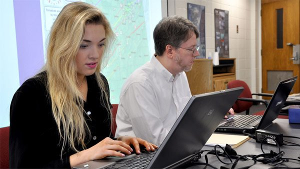 Professor John Knox, right, and student Synne Brustad research tornado debris data. (Source: The University of Georgia)