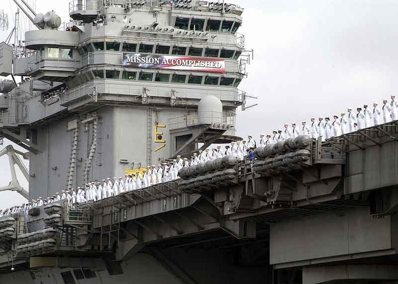 "The USS Abraham Lincoln shown with the ""Mission Accomplished"" banner that was the backdrop for a famous speech given by President George W. Bush. (Source: U.S. Navy/Wikimedia Commons)"