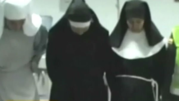 An airport police officer said he stopped the nuns because they looked nervous. (Source: Caracol TV/CNN)