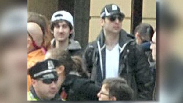 The body of Tamerlan Tsarnaev, pictured (right) alongside his brother Dzhokhar, has been laid to rest after a week of uncertainty on where it would be taken. (Source: FBI/CNN)