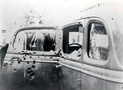 A picture taken shortly after the shootout that claimed the lives of notorious criminals Bonnie Parker and Clyde Barrow shows the bullet-riddled car the two were riding in. (Source: FBI/Wikimedia Commons)