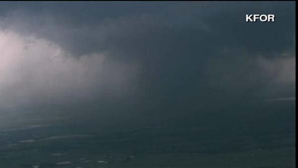 A large and violent tornado twisted through Moore, OK on Monday. (Source: KFOR/CNN)