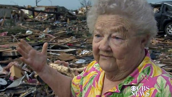 Barbara Garcia was reunited with her lost dog while she was giving a television interview about the tornado. (Source: CBS News)