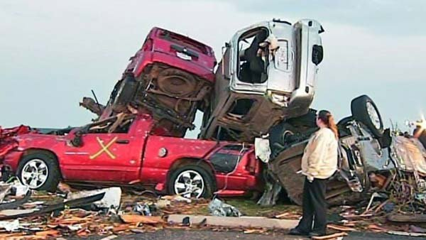 Cars piled on top of one another during the Joplin, MO, tornado. (Source: KOLR/CNN)