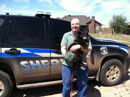Susie, a 12-year-old Schipperke-Border Collie mix and her owner, Curtis Collins, had a joyful reunion when he found her thanks to the post on Facebook. (Source: Oklahoma County Sheriff's Office)