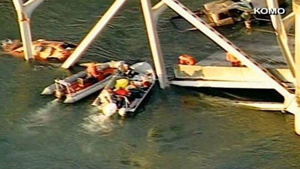 Rescue boats worked to pull passengers from the river. (Source: KOMO/CNN)