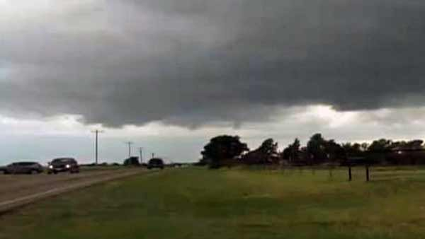 A large wall cloud traveled between Perkins and Ripley in central Oklahoma on Thursday afternoon. (Source: KFOR/CNN)