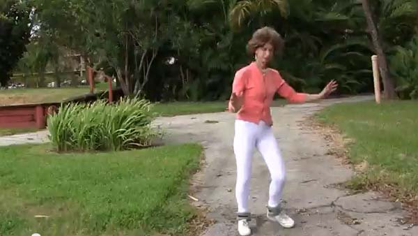 Joanna Rohrback demonstrates the prancing movement with a pair of ankle weights in her exercise video that is going viral. (Source: YouTube)