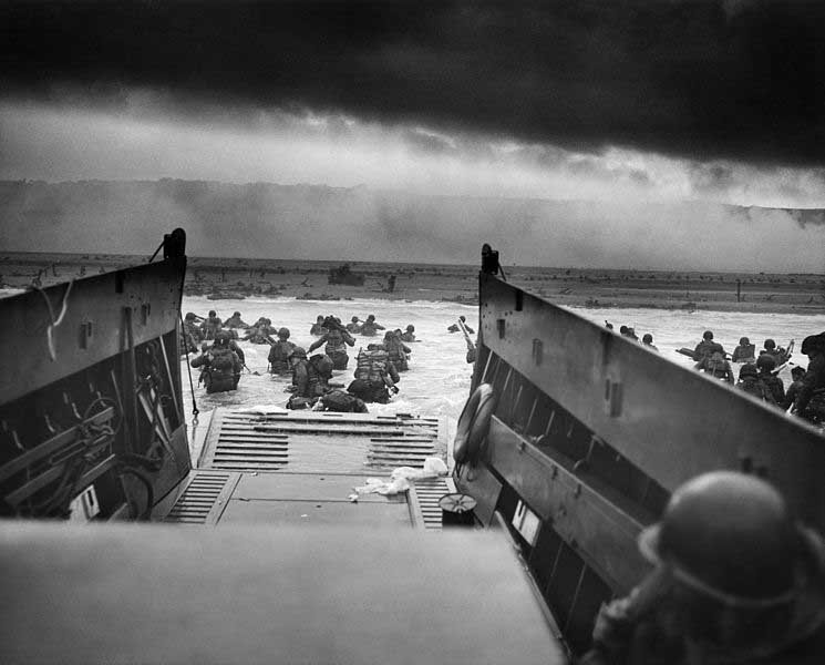 American forces land on Omaha Beach during the D-Day invasion June 6, 1944. (Source: U.S. Coast Guard/Wikimedia Commons)