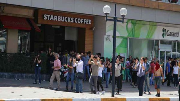 Protesters march past a Starbucks. (Source: Arzu Geybulla)