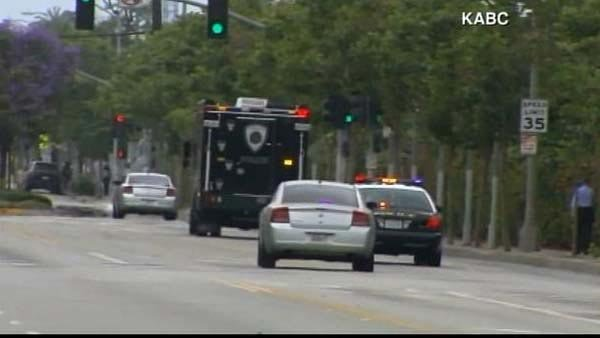 Police and first responders head towards a reported shooting near Santa Monica College Friday. (Source: KABC/CNN)