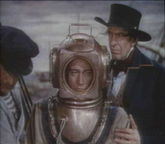 John Wayne preparing to dive to his character's death in Reap the Wild Wind. (Source: Wikimedia Commons)