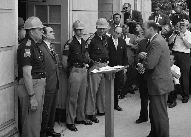 George Wallace stands in the door of Foster Auditorium at the University of Alabama to stop the enrollment of two African-American students June 11, 1963. (Source: Library of Congress/Wikimedia Commons)
