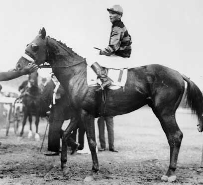 Sir Barton, the first Triple Crown winner and jockey Johnny Loftus in 1919. (Source: Wikimedia Commons)