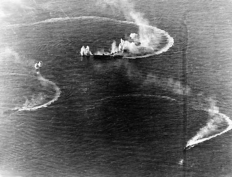 A Japanese aircraft carrier and two destroyers are attacked during the Battle of the Philippine Sea. (Source: U.S. Navy/Wikimedia Commons)