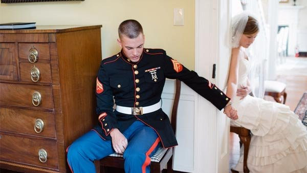 Photographer Kimberly Burke captured soon-to-be newlyweds Josh Curtas and Bre Curtas praying together before their wedding. (Source: Kimberly Burke)