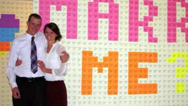 Bret Beutler asked girlfriend Megan Loosli to marry him ... with 8,000 sticky notes. (Source: Deanna Beutler/CNN)