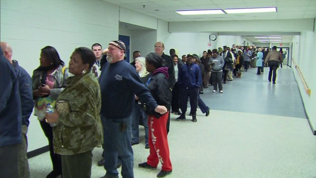 People wait in line to vote during a recent election. (Source: CNN)